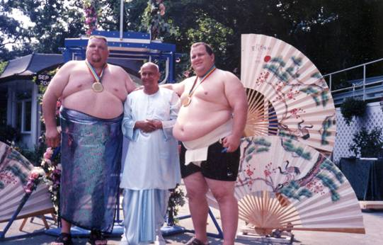 Sri Chinmoy with Sumo wrestlers.